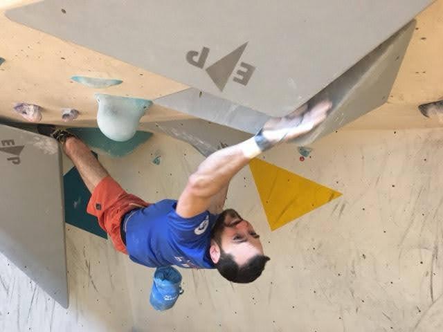 Brett Ffinch climbing an overhanging problem