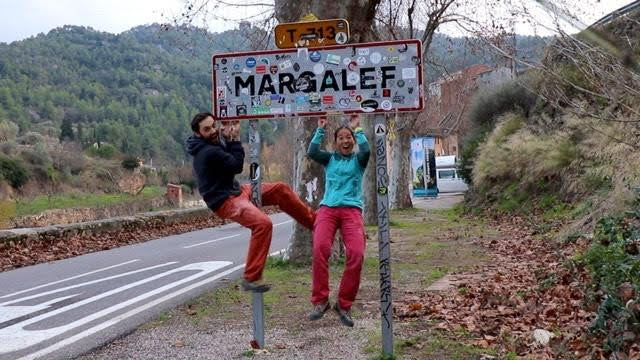 The Climbing Nomads hanging on a sign at margalef, catalonia, spain